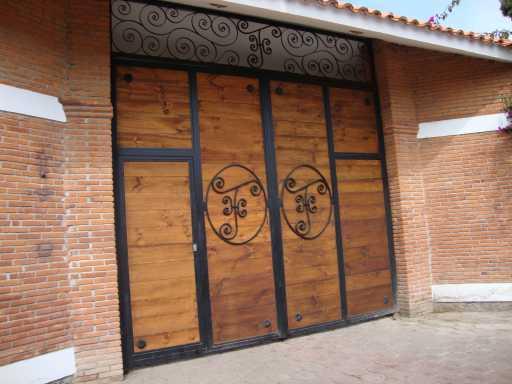 Productos de hierro forjado y acero inoxidable for Saguan de madera