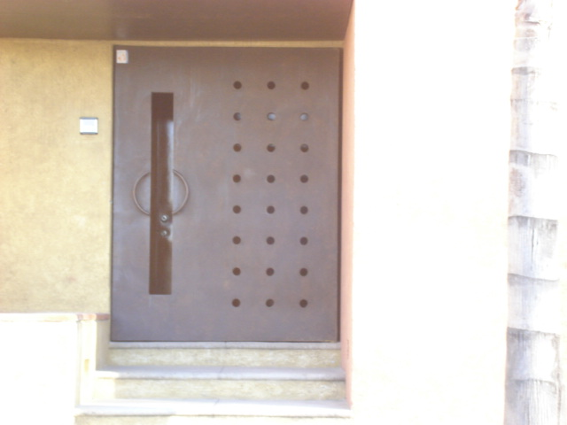 Productos de hierro forjado y acero inoxidable for Puertas de lujo de herreria